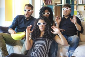 4 People Watching Tv with 3D Glasses